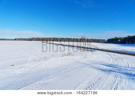 Winding country road in the winter landscape