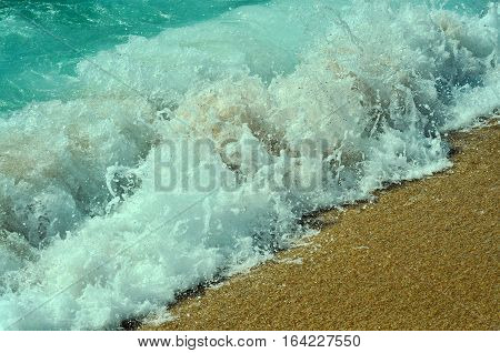 relax sunbathe travel transience concept. aquamarine blue sea ocean waves of water with white foam falling on golden sand background.