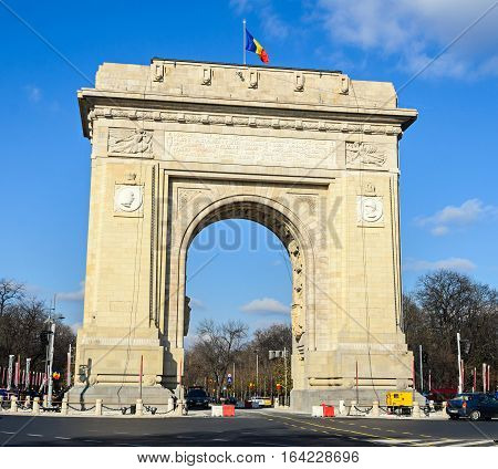 The Arch Of Triumph (arcul De Triumf) From Bucharest Romania, National Day With Romanian Flag