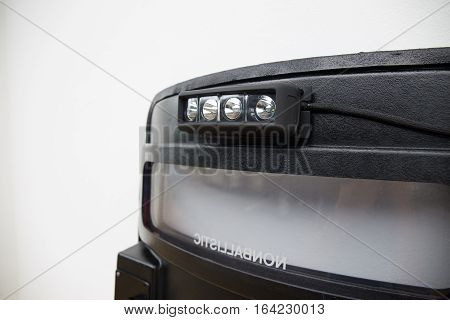 close up black tactical ballistic shield with flash light for S.W.A.T or law enforcement attack team isolated on white background with copy space