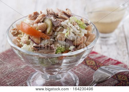 Salad of tuna fish with string beans cucumber tomato and lettuce.