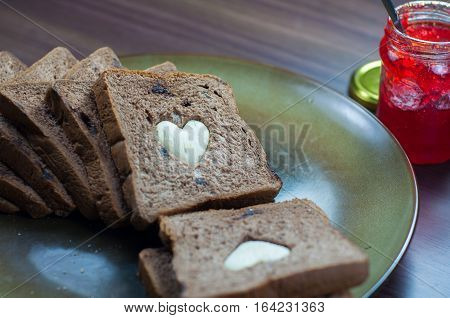 photo love bread. bread valentine. photo love delicious slice of bread with strawberry jam sweetener. is suitable for decorating the nuances of affection