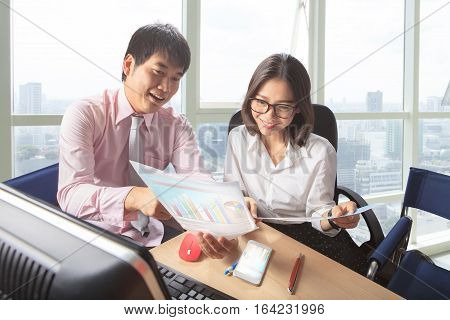 younger man and woman meeting in office working table scene for people business lifestyle