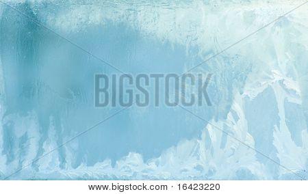 White wintry hoarfrost background on a window