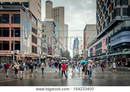 Melbourne Australia - December 27 2016: People crossing the intersection of Elizabeth and Flinders street in Melbourne City Business District
