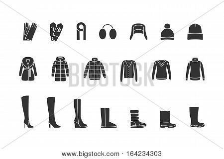 Winter clothes and shoes black icons set. Vector