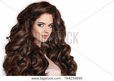 Brunette. Long Hair. Curly Hairstyle. Beautiful Woman With Wavy Healthy Hair Isolated On Studio Whit