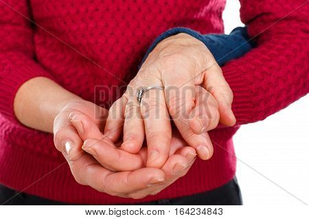 Close up picture of a senior woman's hands with her grandchild