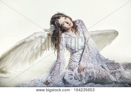 Woman Angel With White Wings Costume In A Religious