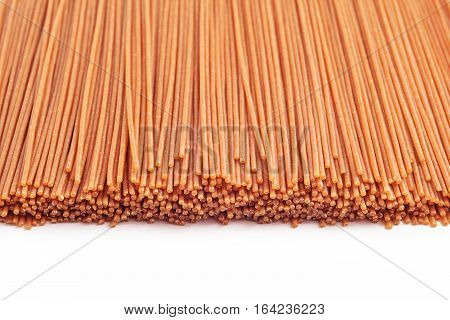 spaghetti raw wholewheat pasta studio isolated on white