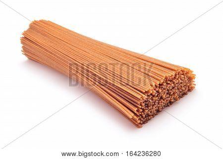 raw whole grain spaghetti pasta studio isolated