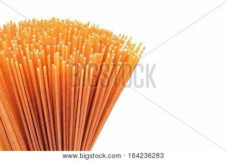 spaghetti raw whole grain pasta studio isolated