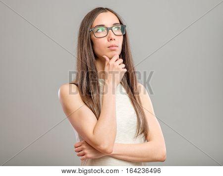 Pensive Woman In Glasses
