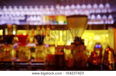 blur purple light counter of bar and pub in dark night background