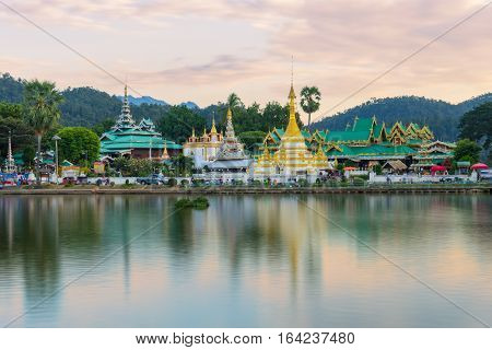 Sunset scence of Wat Jongklang temple - Wat Jongkham temple the most favourite place for tourist in Mae hong son near Chiang mai Thailand with reflect sky in water