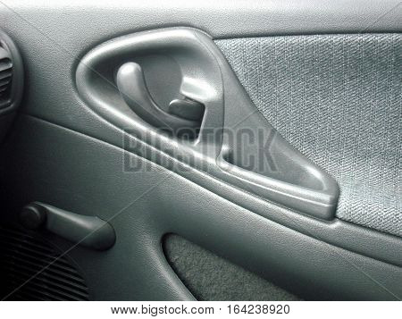 Car door interior abstract on display in gray leather.