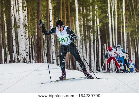 Kyshtym Russia - March 26 2016: group of skiers men in winter forest free style in mountain during Championship on cross country skiing