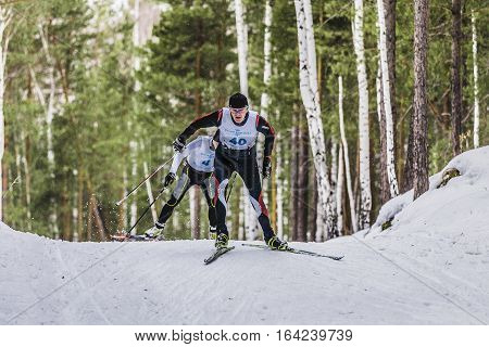 Kyshtym Russia - March 26 2016: two skiers men in forest free style during Championship on cross country skiing