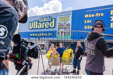 TV team from Chanel 5 Sweden rcording in front of the Warehouse Gekås in Ullared, Sweden, June 28, 2016. It is the largest mall in Scandinavia. The big blue superstore that started back in 1963 is currently Sweden's most popular visitor attraction.