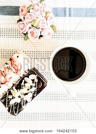 chocolate cake and vanilla cake with coffee cup