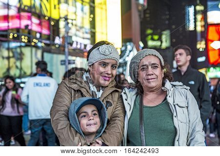 Tourists Have A Photograph As Souvenir At Times Square By Night