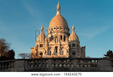 The basilica Sacre Coeur is a Roman catholic church located at the summet of the butte Montmartre the highest point in Paris.