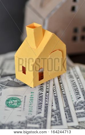 Miniature Paper Made House Stand On  Money