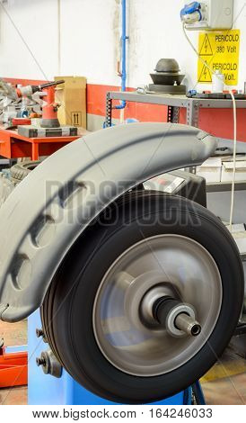 a tire turning fast in balancing machine