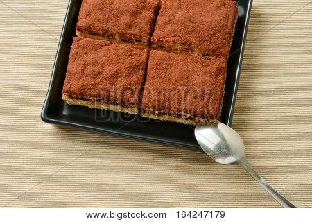 Tiramisu cake on plateau with side light