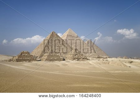 Panoramic view of pyramids from the Giza Plateau (three pyramids known as Queens' Pyramids on front side; next in order from left: the Pyramid of Menkaure Khafre and Chufu Cairo Egypt