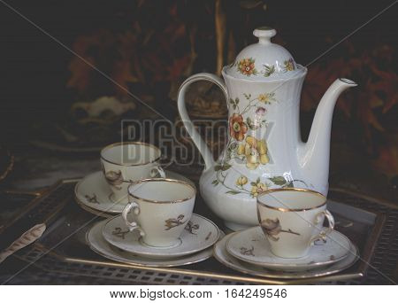 Teapot with cup. Luxuary teapot in vintage style.(vintage effect)