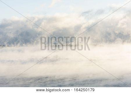 Island far in distance in a steamy sea
