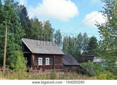 Russia, village, wooden house with annexe over the fence