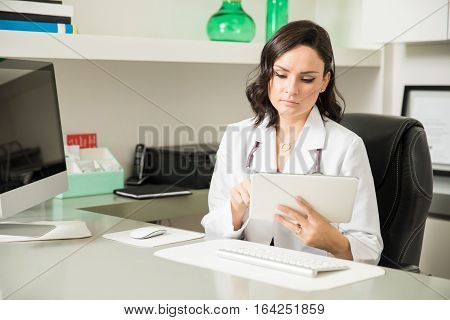 Female Doctor Using Technology In Her Office