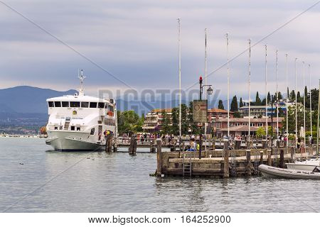 Sirmione, Italy - July 31: People On Ferry Sail From Pier On 31 July 2016 In Sirmione, Italy.