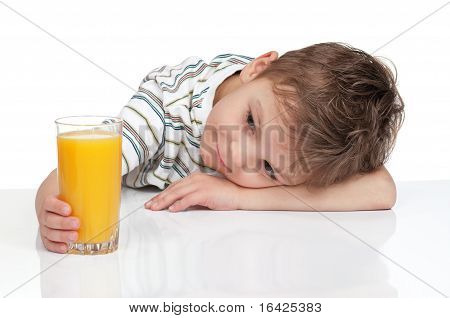 Boy with a glass of juice