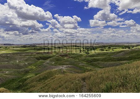 Rolling Hills Badlands National Park with clouds and blue sky