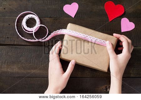 Packaging Valentine's Day Gifts. Valentine's Day Gifts With A Pink Ribbon On A Wooden Table. Top Vie
