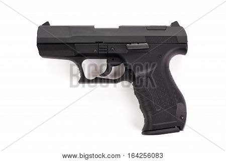 Black handgun pistol isolated on white background