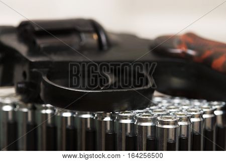 Revolver and a lot of ammunition on a white background