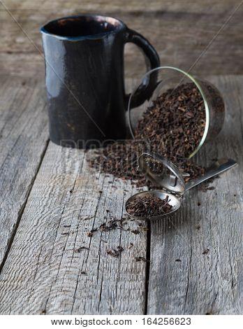 Tea brews on vintage grey boards with copy space