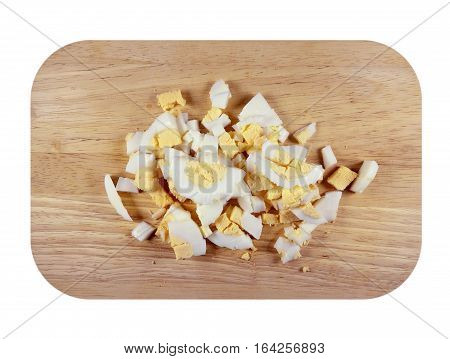 Chopped boiled eggs on a kitchen wooden board isolated on white. Clipping Path included