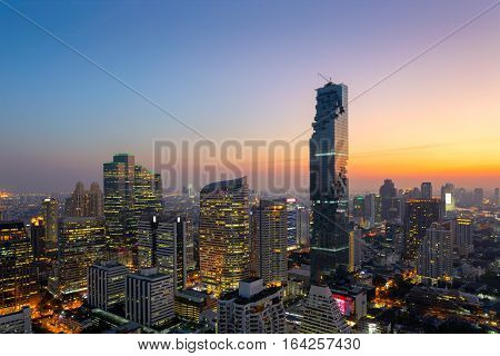 Aerial view of Bangkok modern office buildings condominium in Bangkok city downtown with sunset sky Bangkok is the most populated city in Southeast Asia. Bangkok Thailand
