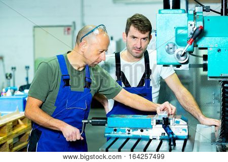 Two Worker In Factory