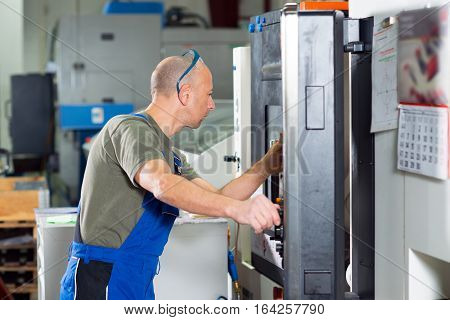 one worker in factory on the machine