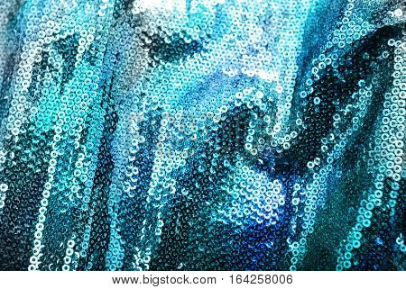 sequins background of deep blue with overflow