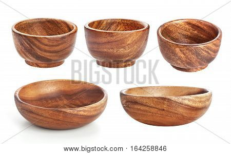 Empty wooden bowl isolated on white background with clipping path