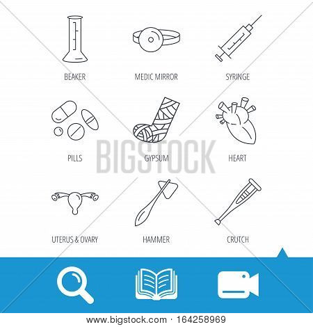 Syringe, beaker and pills icons. Crutch, medical hammer and mirror linear signs. Heart, broken leg and uterus ovary icons. Video cam, book and magnifier search icons. Vector