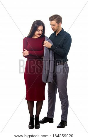 Young Man Puts His Jacket On A Girl In A Red Dress