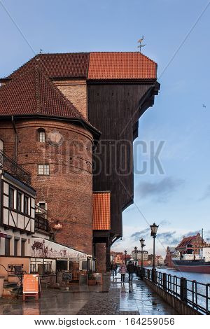POLAND GDANSK - DECEMBER 18 2011: A side view of the famous medieval Crane (Zuraw). Is a historical city gate with the function of the lifting mechanism. Built in 1442-1444.